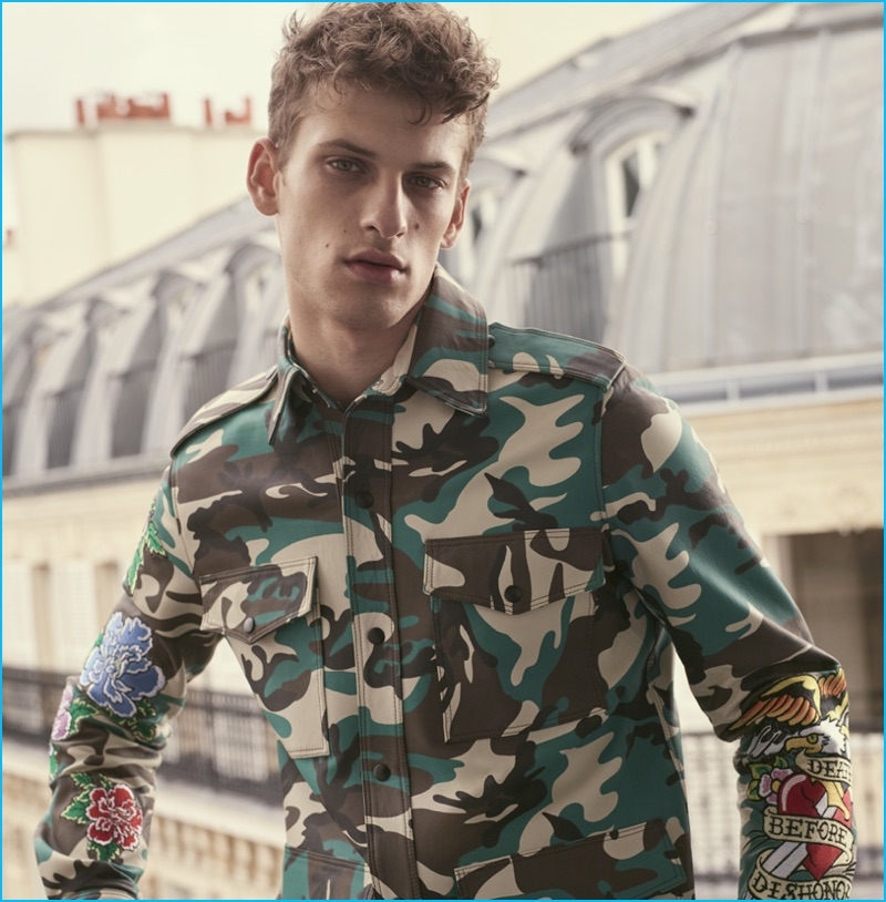 David Trulik rocks a camouflage jacket for Cesare Paciotti's Wild Dagger fall-winter 2016 campaign.