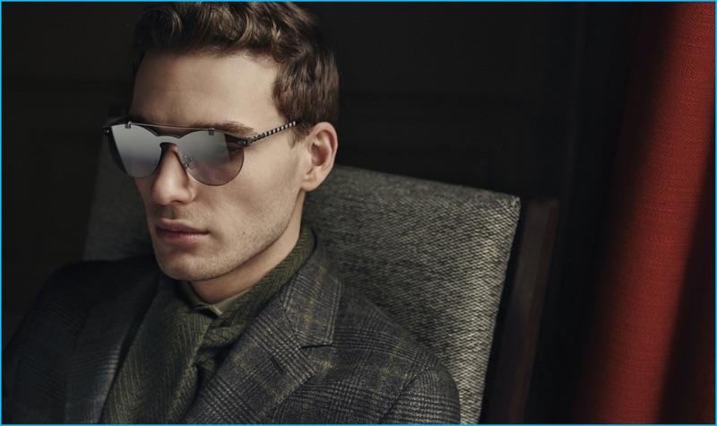 Nikola Jovanovic sports modern sunglasses and a wool check suit Ermenegildo Zegna's fall-winter 2016 collection.