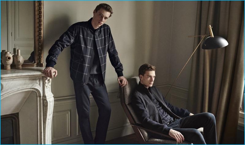 Models Nikola Jovanovic and Tommaso de Benedictis don windowpane print fashions from Ermenegildo Zegna's fall-winter 2016 collection.
