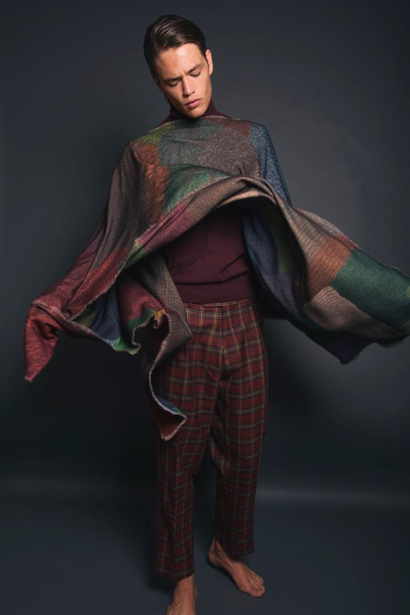 Raffaele wears poncho Pierre-Louis Mascia, sweater Pence 1979, and trousers Berwich.