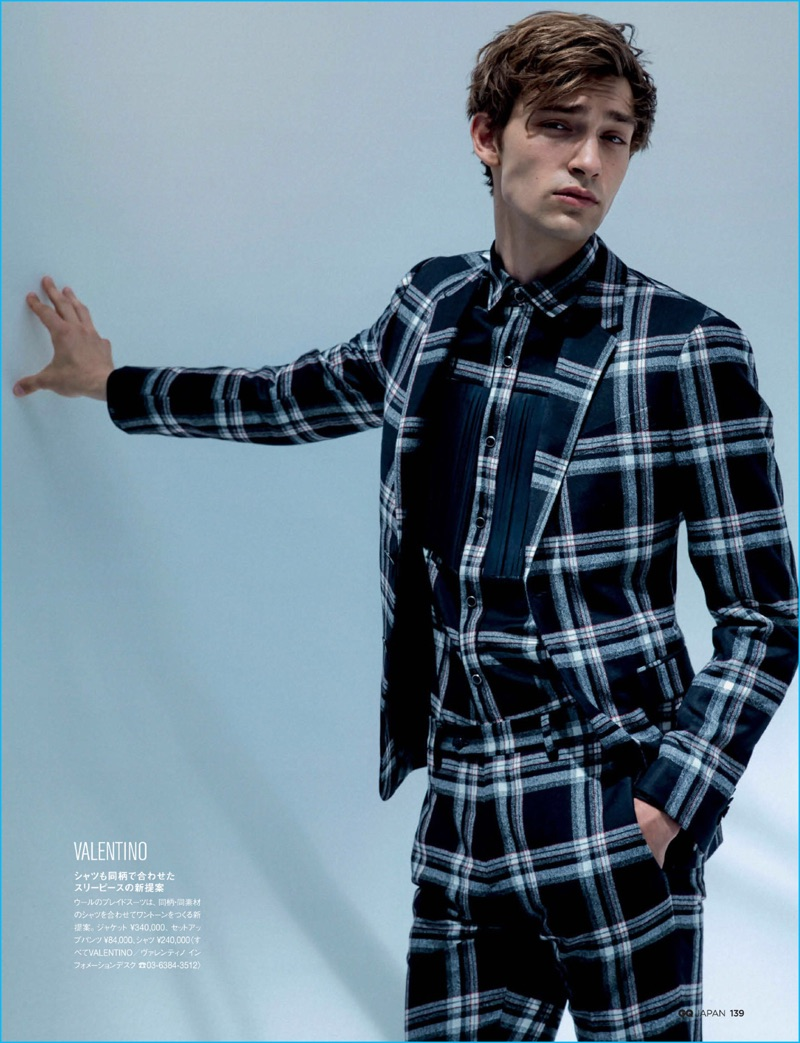 George Le Page models a tartan print suit from Valentino for GQ Japan.