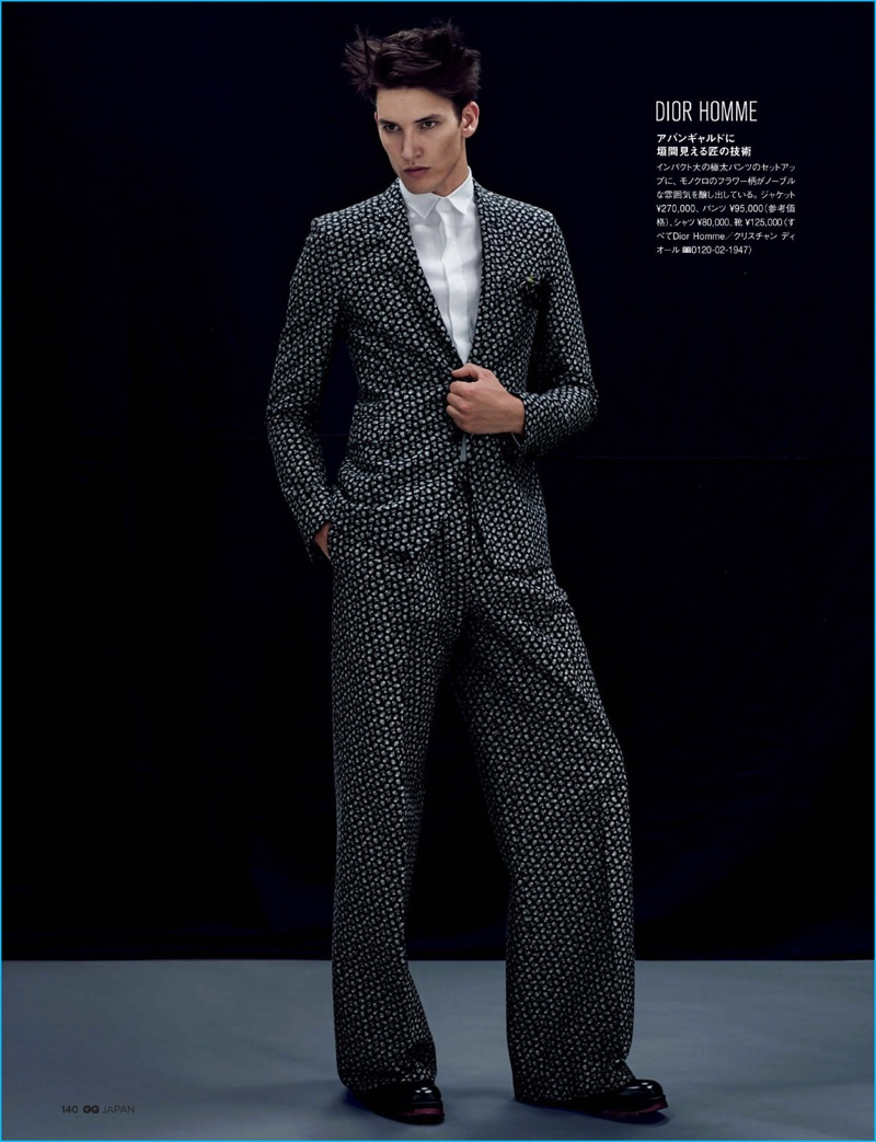 Dominik Bauer pulls off a wide-leg trousers and sharp blazer from Dior Homme for GQ Japan.