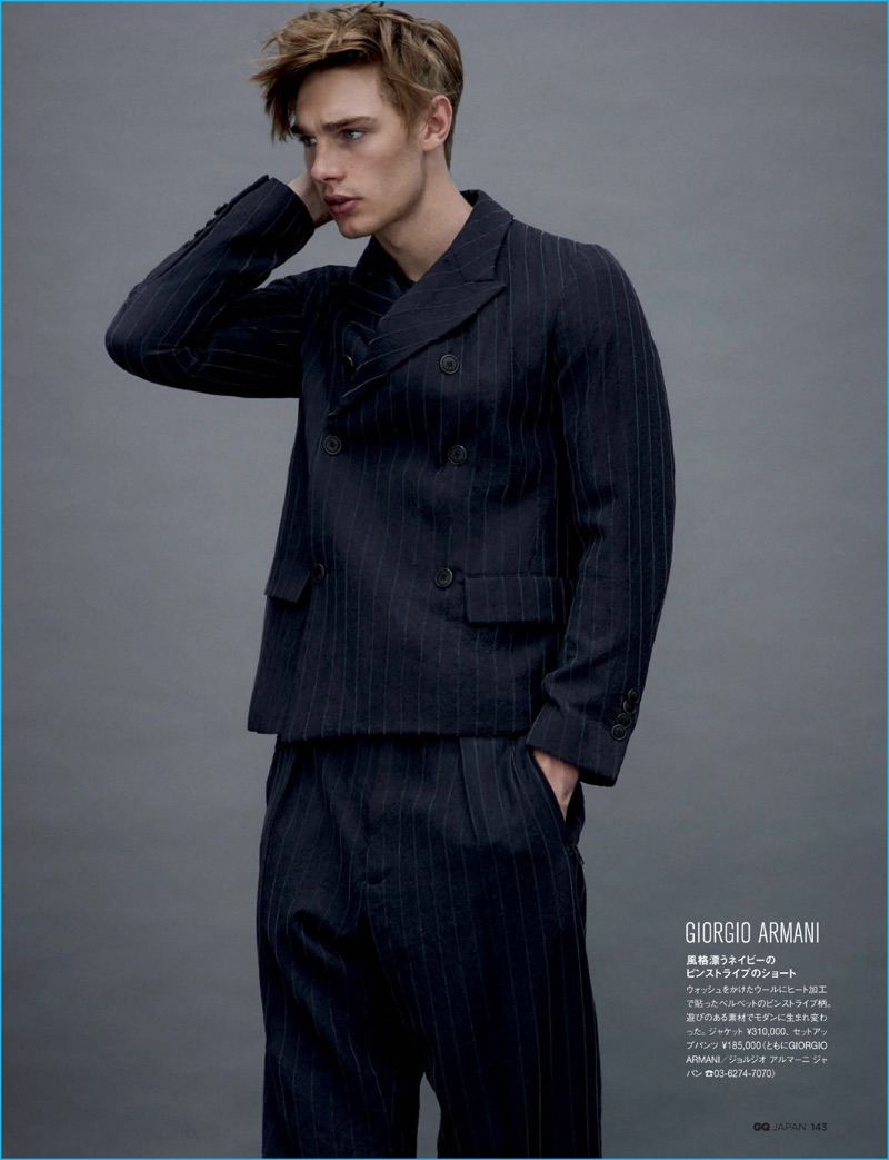 Tommy Marr sports a pinstripe double-breasted suit from Giorgio Armani for GQ Japan.