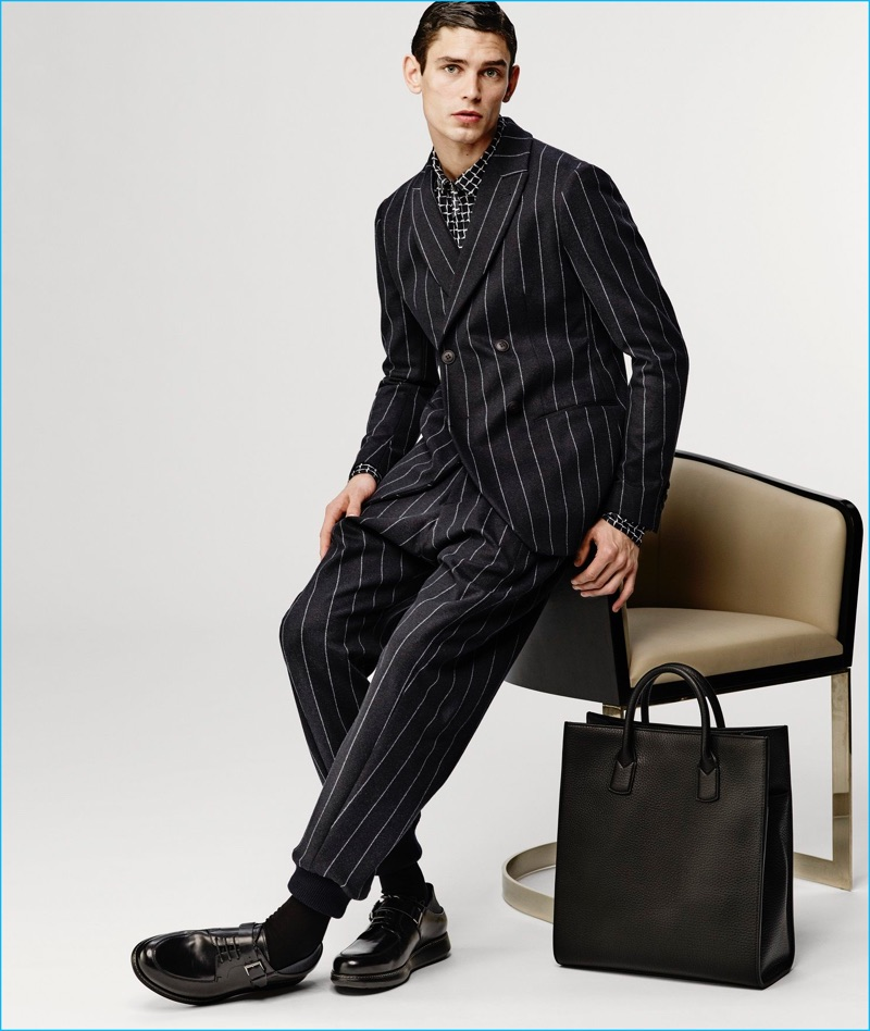 Arthur Gosse dons a pinstripe suit from Giorgio Armani's fall-winter 2016 collection.