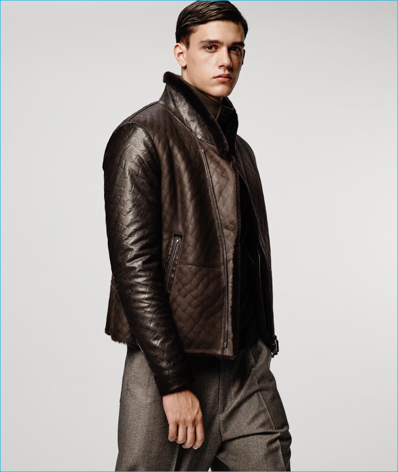 Xavier Serrano sports a leather jacket and wide-leg trousers from Giorgio Armani's fall-winter 2016 collection.