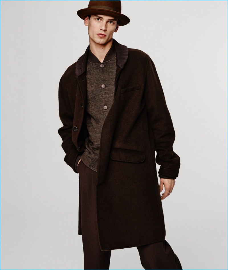 Arthur Gosse charms in an oversized single-breasted coat from Giorgio Armani's fall-winter 2016 collection.