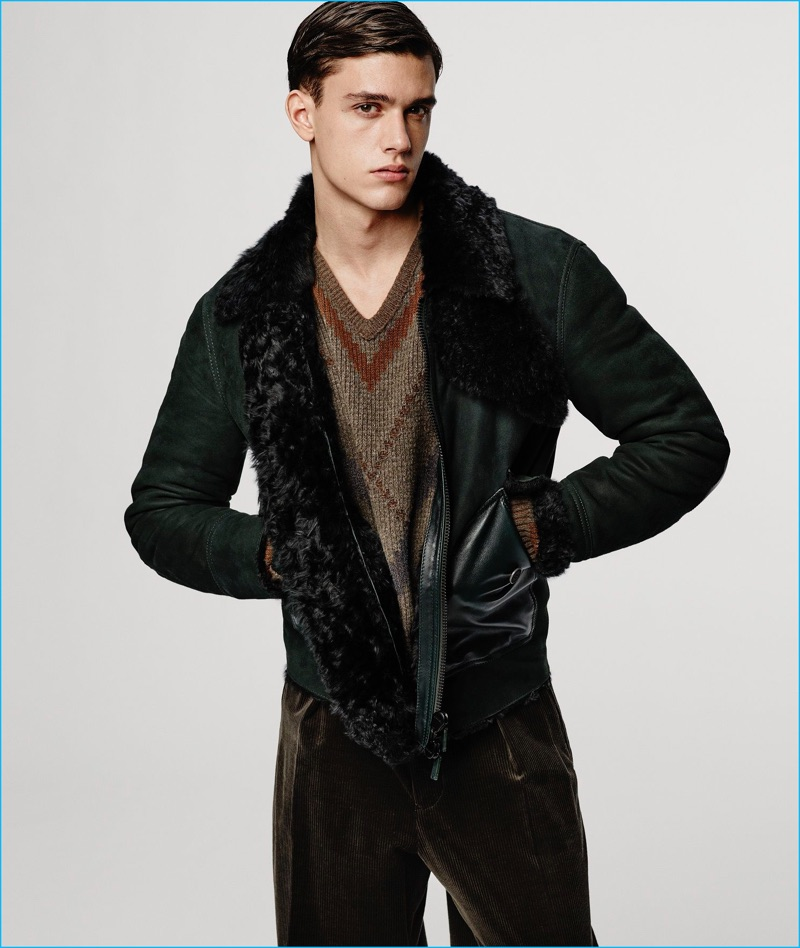 Xavier Serrano dons a suede jacket and autumnal hued v-neck sweater from Giorgio Armani's fall-winter 2016 collection.