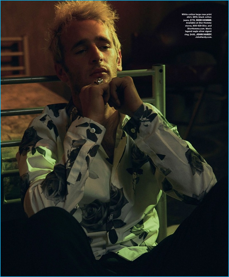 Hopper Penn dons a rose print shirt from Parisian label Dior Homme.
