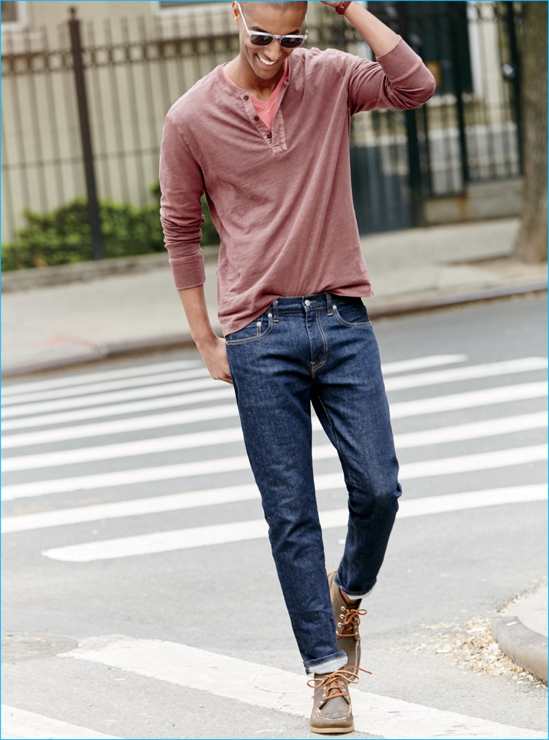 Claudio Monteiro takes to the streets in a henley, v-neck and denim jeans from J.Crew.