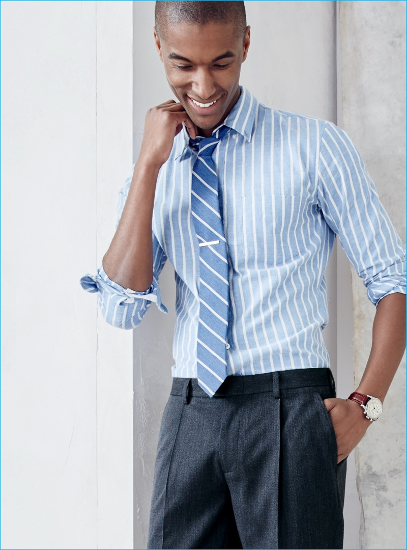 Claudio Monteiro dons a striped dress shirt and tie from J.Crew.