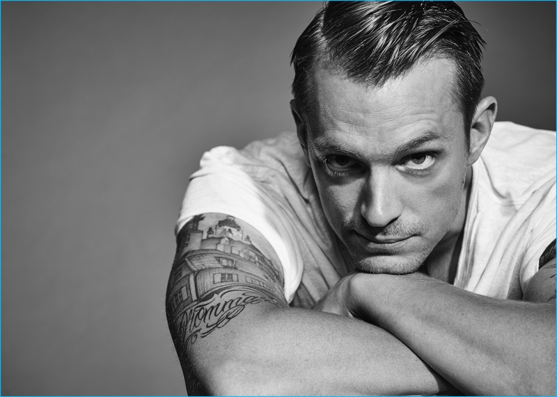 Joel Kinnaman photographed by Dani Brubaker in a t-shirt from AllSaints.