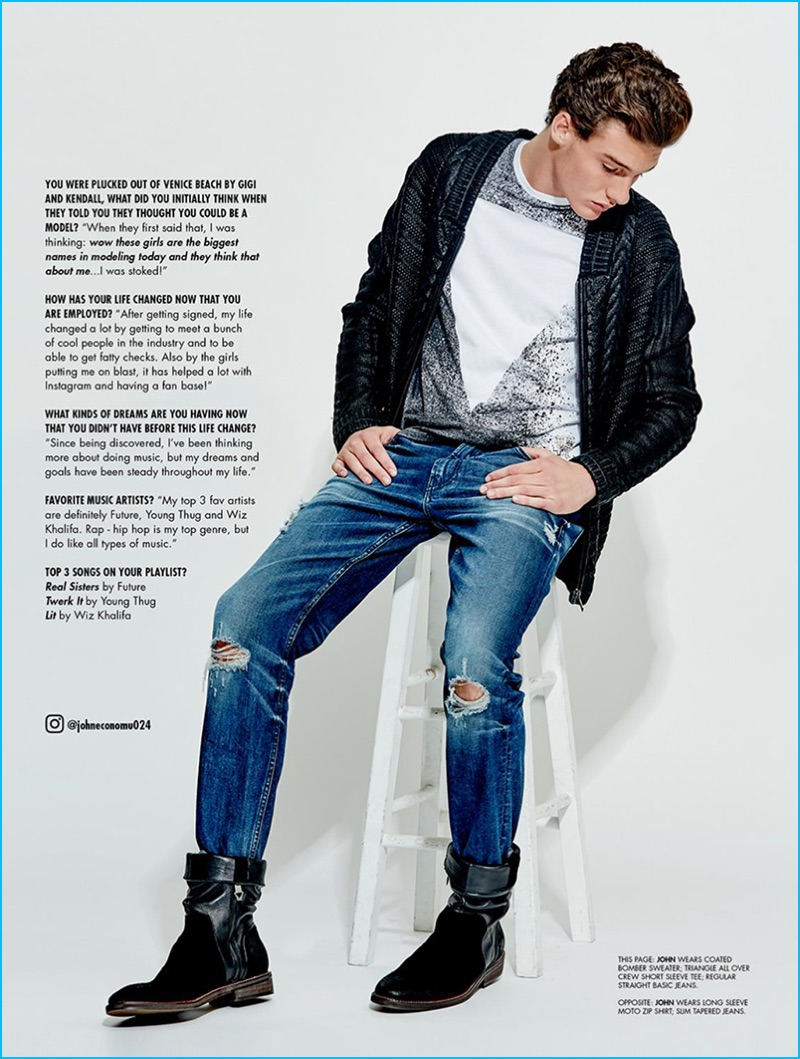 John Economou goes casual in a graphic t-shirt, cardigan sweater, ripped distressed denim jeans, and leather boots from Guess.