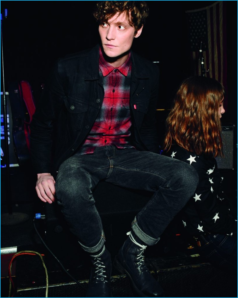 Matthew Hitt models Levi's 505C slim fit denim jeans.
