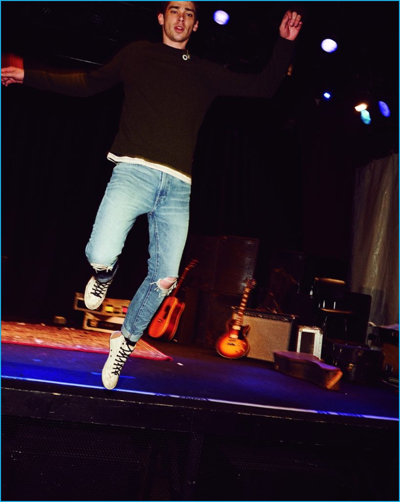 Cole Mohr jumps off the stage, wearing Levi's 505C Joey slim fit denim jeans.