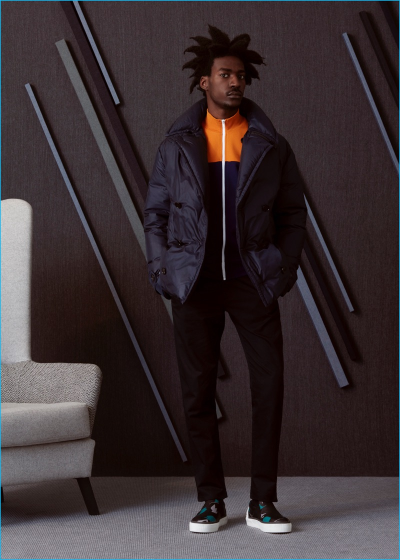 Boyd wears camouflage sneakers Lanvin, track jacket, down-filled jacket, and trousers Maison Margiela.
