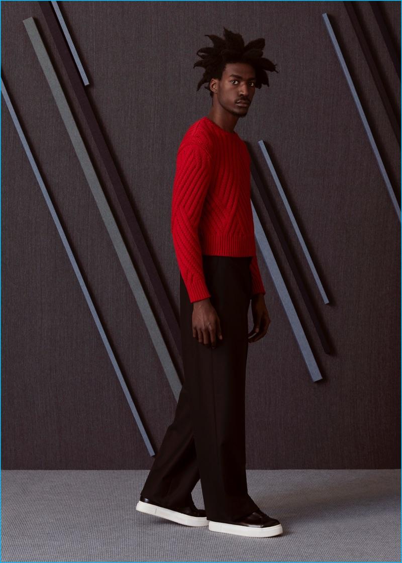 Boyd wears knit chevron sweater Neil Barrett, wide-leg trousers Lanvin, and sneakers EYTYS.
