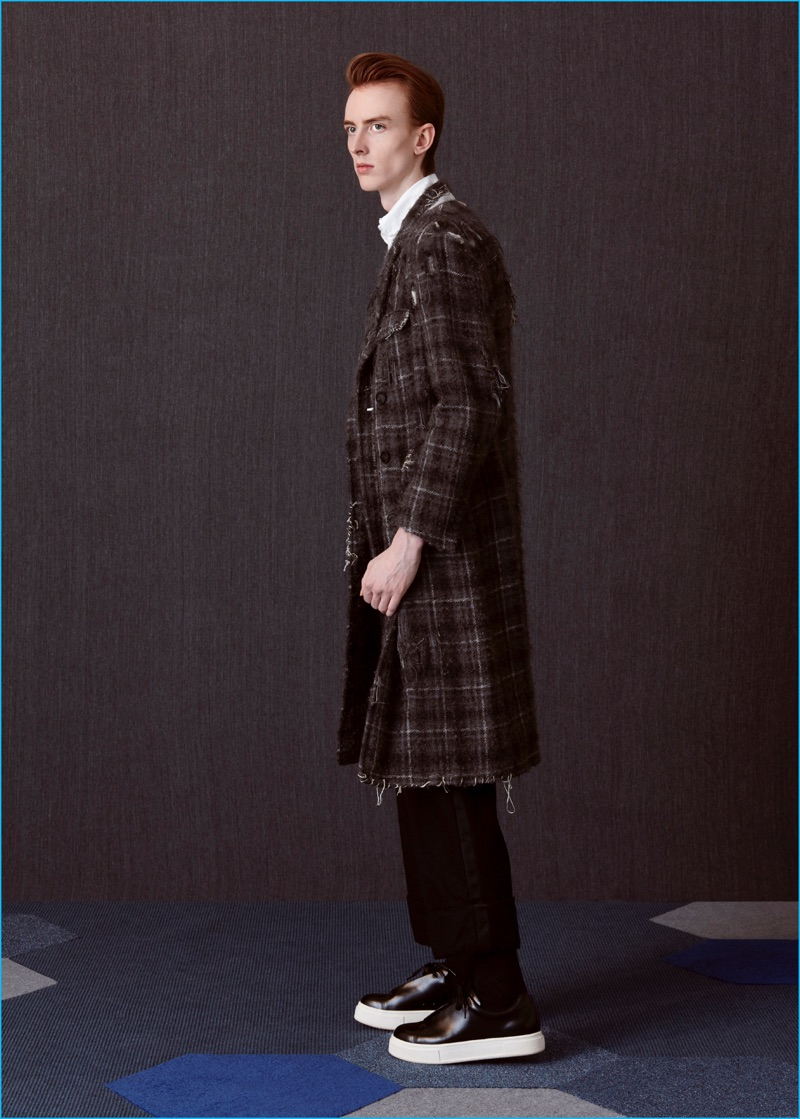 Matthew wears sneakers EYTYS, destroyed plaid overcoat and tuxedo trousers Thom Browne.