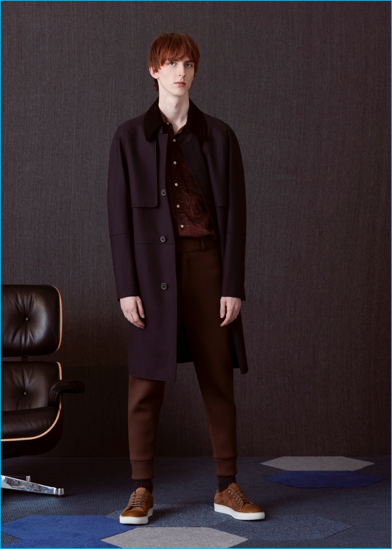 Matthew wears belted overcoat Wooyoungmi, printed shirt Our Legacy, neoprene trousers Neil Barrett, and suede sneakers Lanvin.