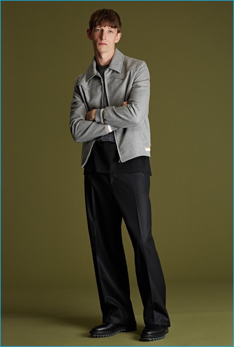 Lanvin grey felt Harrington jacket, striped panel t-shirt, charcoal wide-leg trousers, and black shark-sole leather shoes.