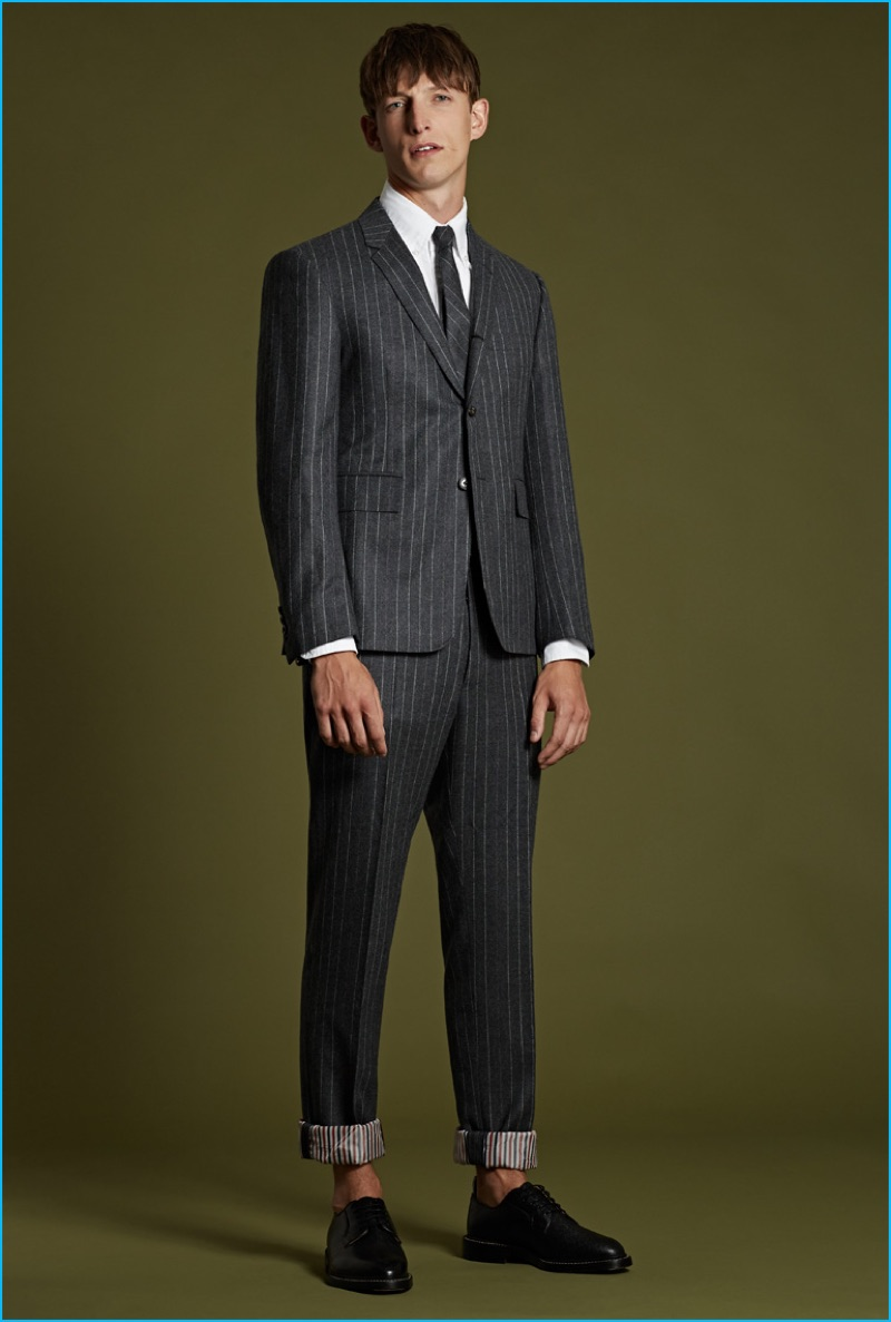 Thom Browne charcoal pinstriped suit, white cotton oxford shirt, grey pinstriped wool tie, and black pebblegrain leather brogues.