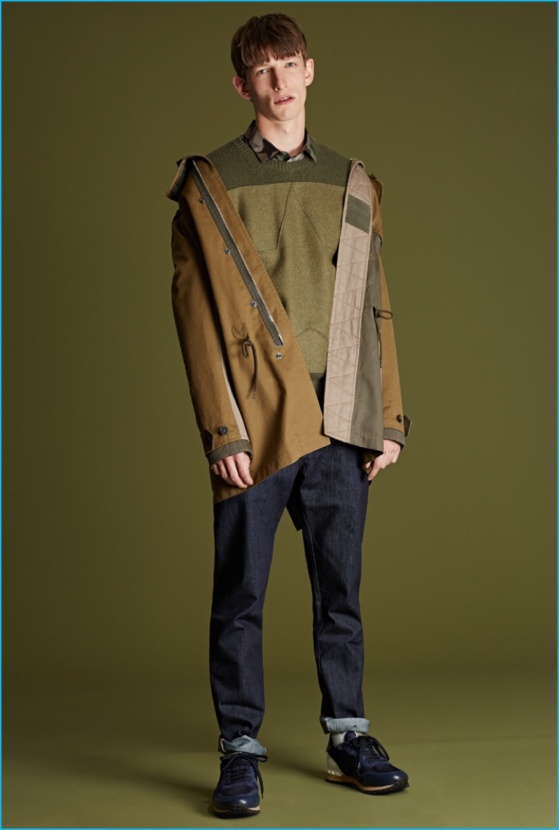 Valentino military-style sweater, patchwork cotton parka, indigo Rockstud denim jeans, and running sneakers.