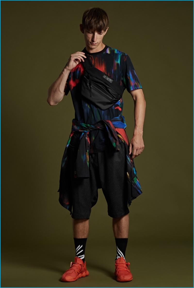 Y-3 black cotton logo socks, orange Kyujo low sneakers, distorted print cotton t-shirt and windbreaker jacket.