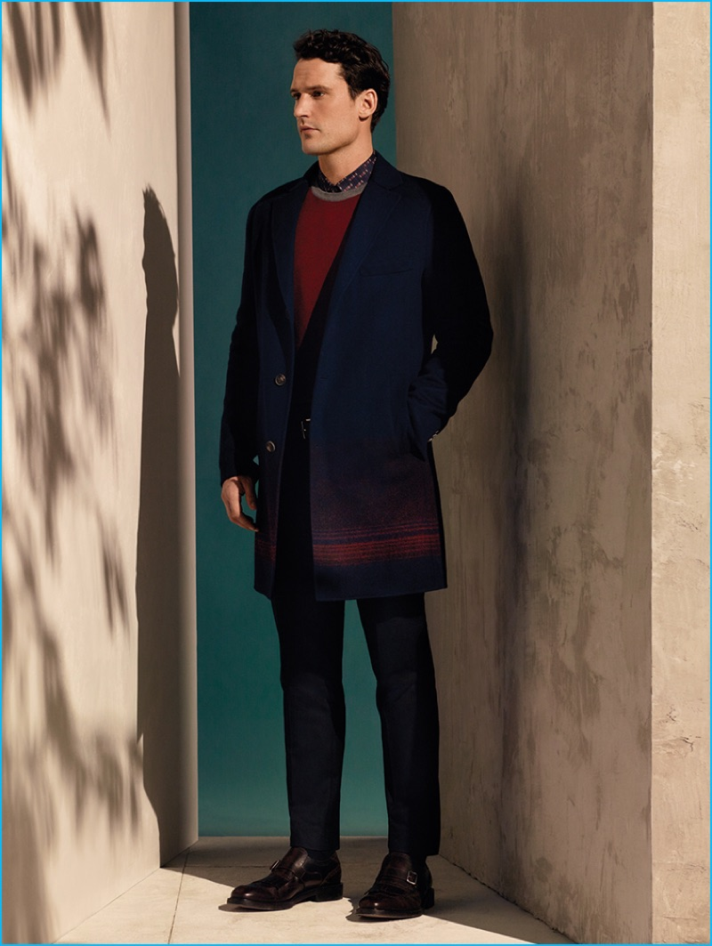 Sam Webb embraces navy and deep red in a look from Salvatore Ferragamo's pre-fall 2016 men's collection.