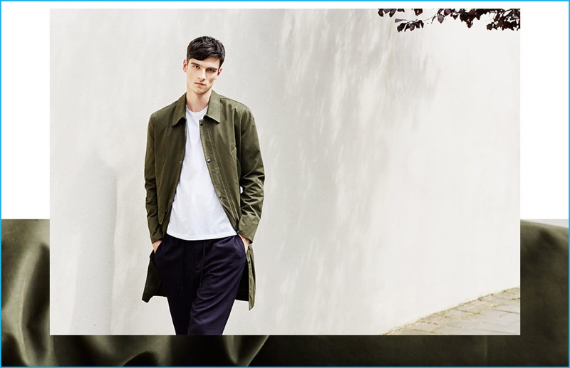 Topman embraces the mac coat, dressing up a simple tee and pinstripe pants for an effortless look.