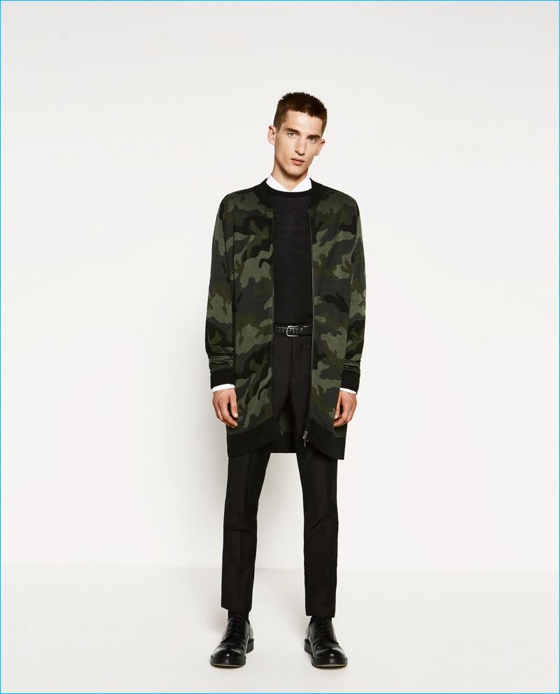 Anatol Modzelewski is pictured in an elongated camouflage knit bomber jacket from Zara Man.