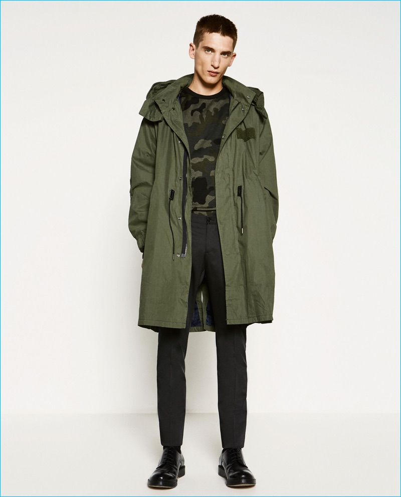 Anatol Modzelewski wears military greens, sporting an oversized parka and camouflage sweater from Zara Man.
