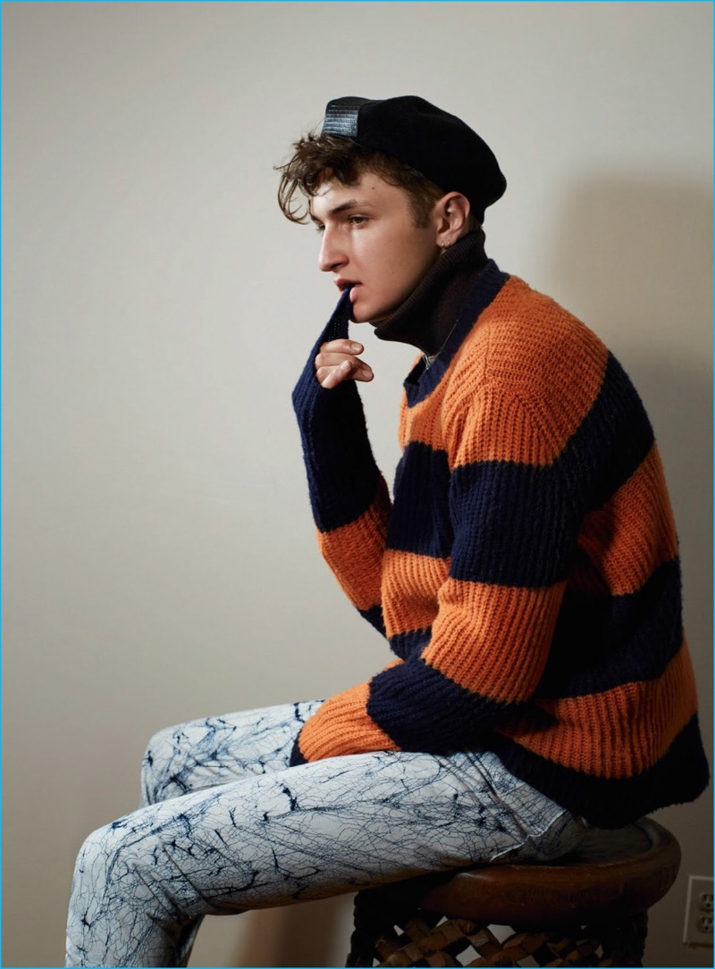 Anward Hadid sports a orange and navy striped sweater from MSGM for Vogue Hommes Paris.