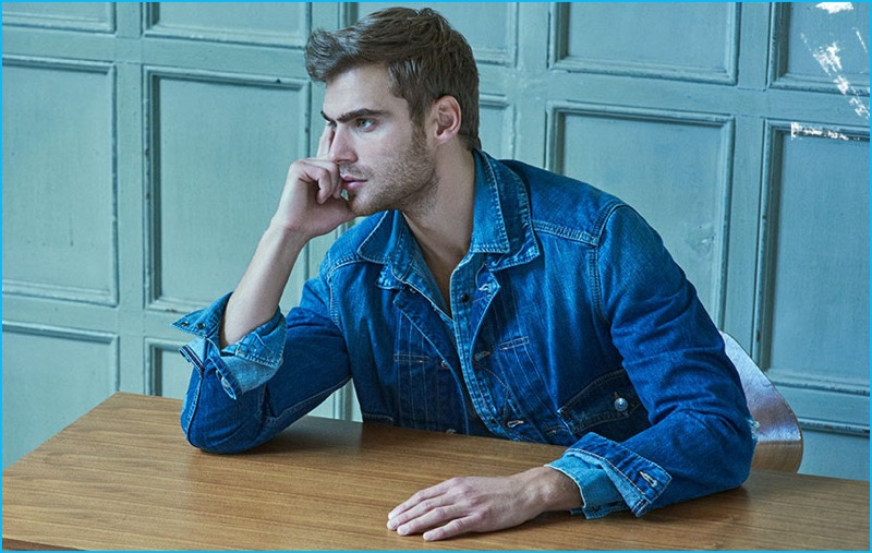 George Alsford doubles down on denim in a Dsquared2 denim jacket with a Kenzo denim shirt.