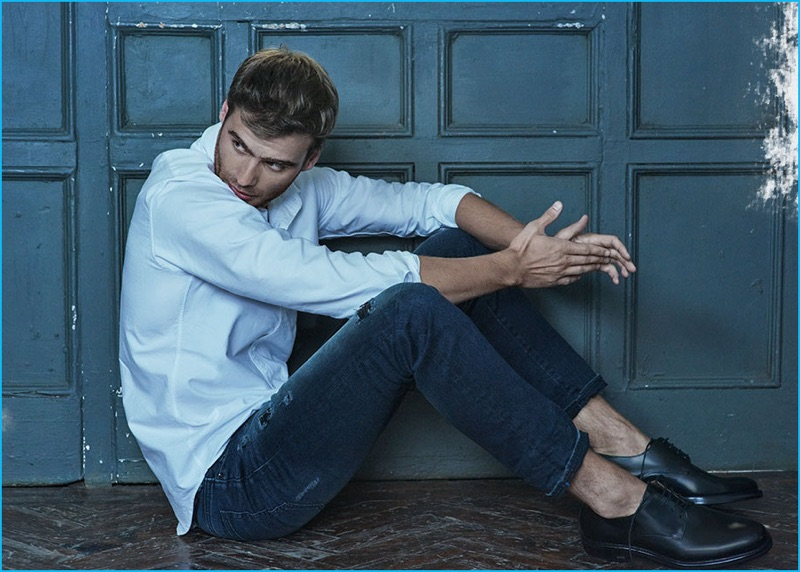George Alsford embraces a simple fit, wearing an Ami oxford shirt with Diesel denim jeans and Ami dress shoes.