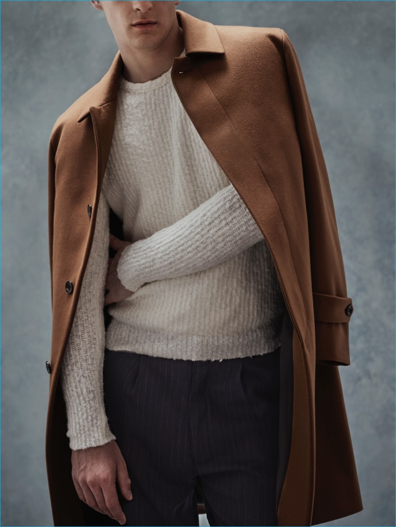 Camel & Cream: Thorben Gartner wears coat Hevo, scarf Brunello Cucinelli, sweater Nuur, and trousers Société Anonyme.