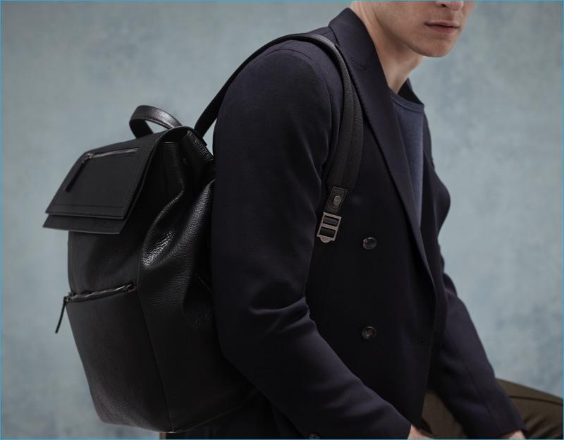 Relaxed Luxury: Thorben Gartner wears blazer Lardini, t-shirt E.Tautz, trousers Marni, and backpack Salvatore Ferragamo.