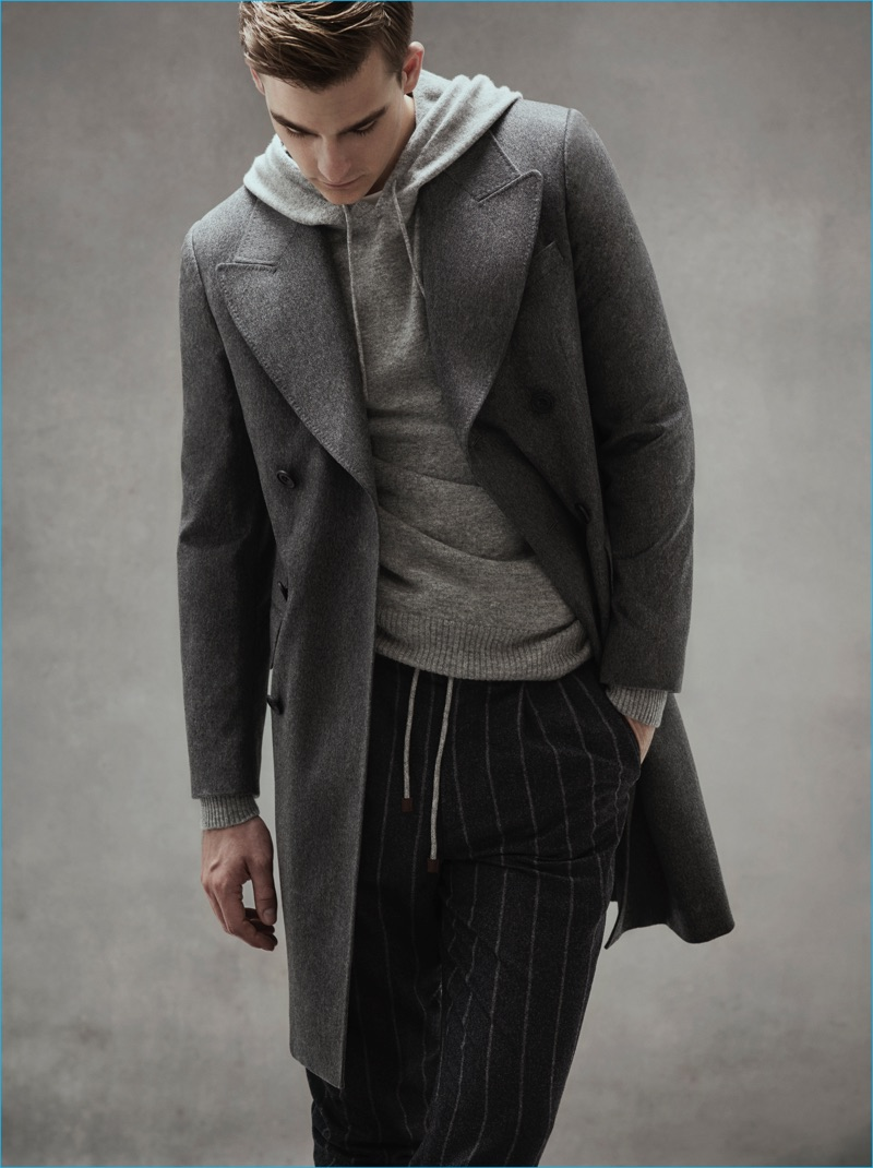 Grey Layers: Thorben Gartner wears grey pinstripe trousers Brunello Cucinelli, coat and knit hoodie E.Tautz.