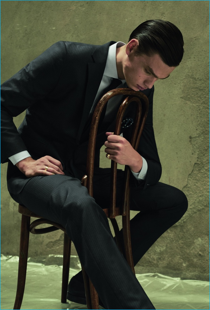 Filip Hrivnak poses for a serious fashion image, wearing a suit from Massimo Dutti.