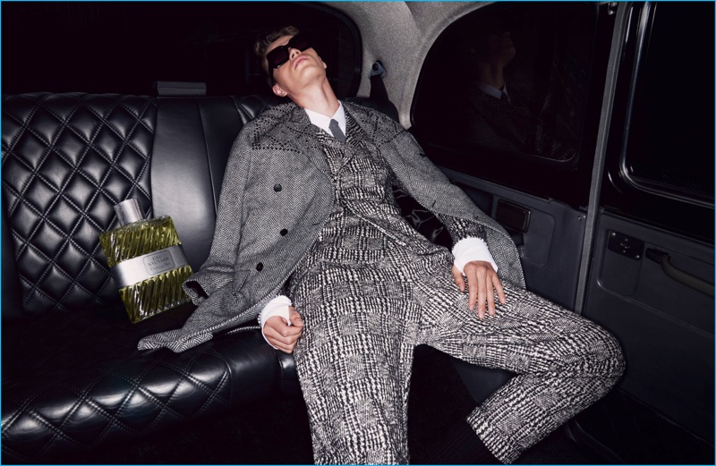 Filip Hrivnak takes it easy in a modern houndstooth suit from Valentino.