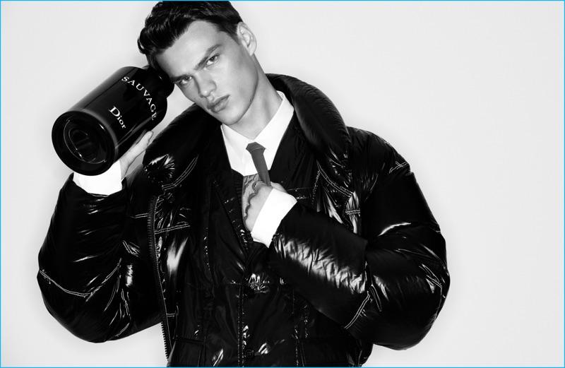 Filip Hrivnak rocks a black puffer jacket from Dior Homme for Elle Men China.
