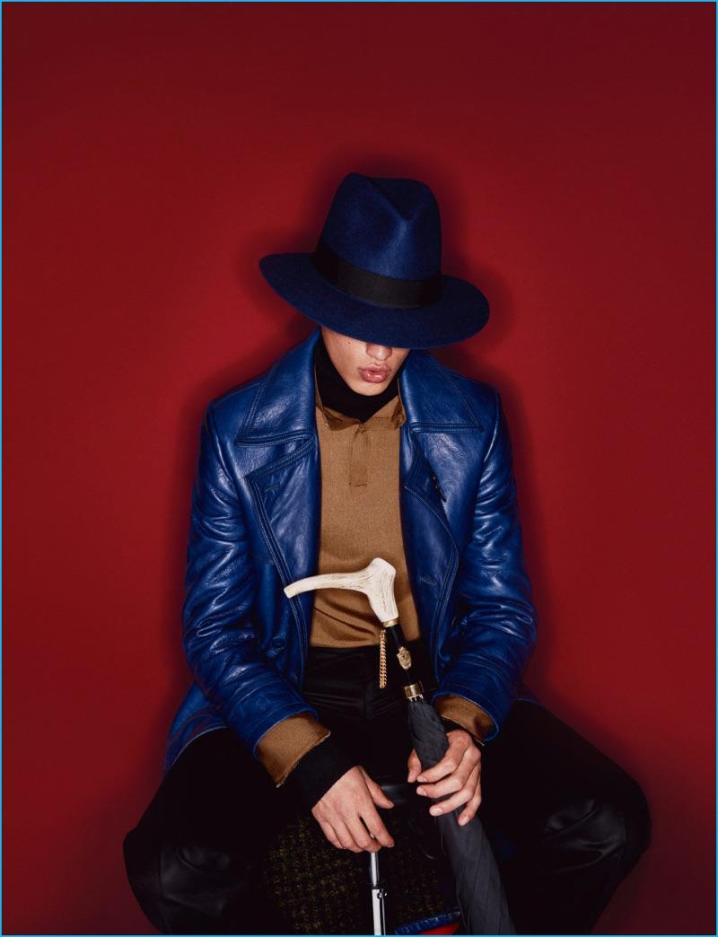 Filip Hrivnak rocks a blue leather coat from Italian label Bottega Veneta.