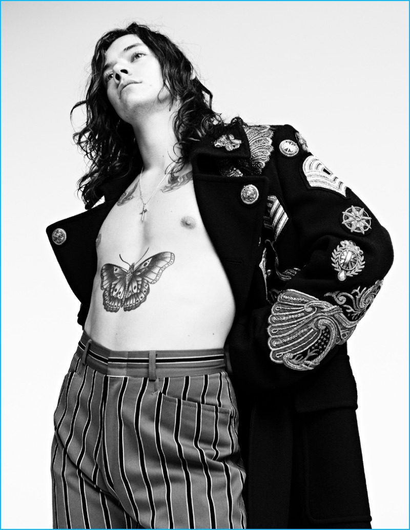 Harry Styles channels military style in a fall-winter 2016 coat from Belgian designer Dries Van Noten.