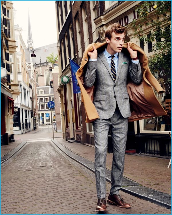 Clément Chabernaud dons a Glen plaid Ludlow suit with a topcoat from J.Crew.