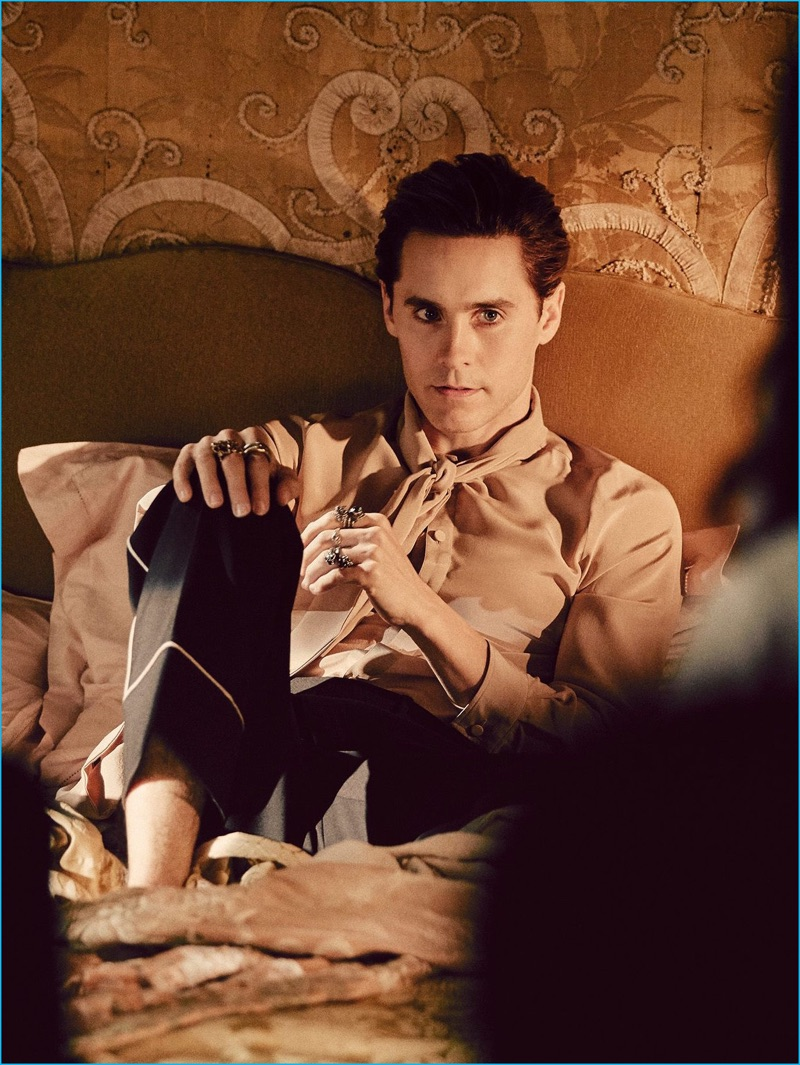 Behind the Scenes: Wearing a silk shirt and scarf from Gucci, Jared Leto relaxes in bed for Gucci Guilty's fragrance campaign.