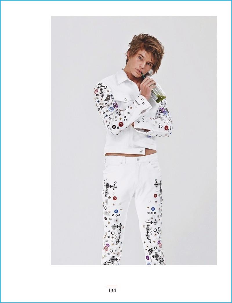 Jordan Barrett wears a flashy white look from Versace for Narcisse magazine.