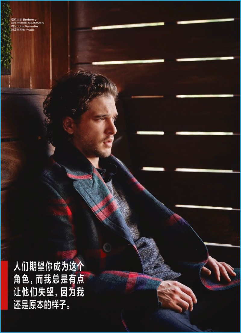 Kit Harington dons a Burberry check coat with casual fashions from John Varvatos and Prada.