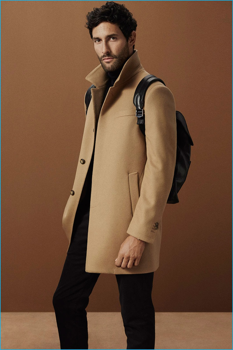 Noah Mills pictured in a single-breasted camel coat from Massimo Dutti.