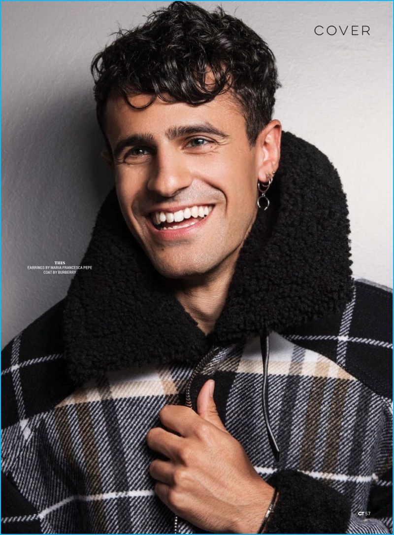Neil Amin-Smith is all smiles in a check Burberry jacket for Gay Times.