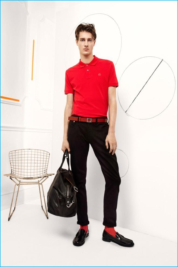 Marc André Turgeon wears a red polo shirt with slim black trousers from Paul Smith's fall-winter 2016 collection.