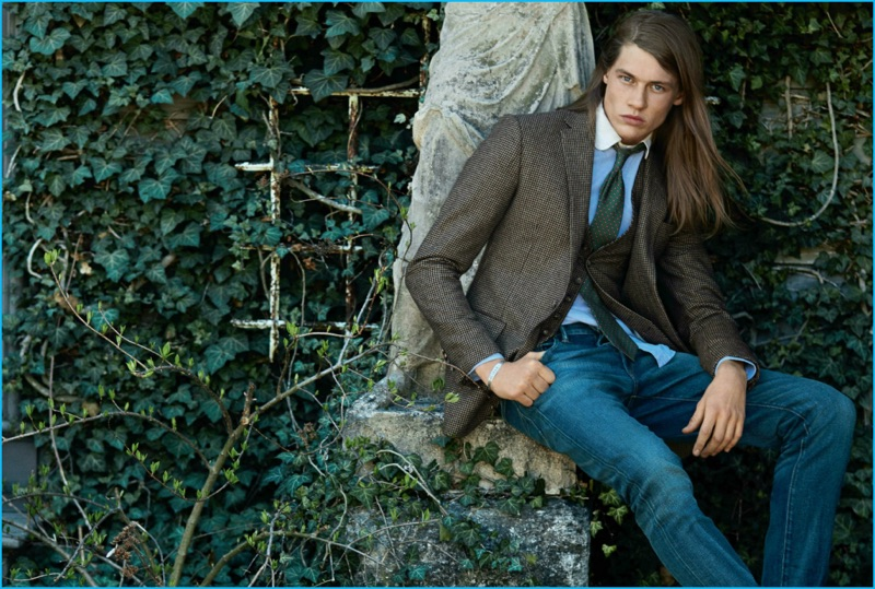 James Phillips models a waistcoat and sport coat with denim jeans for Polo Ralph Lauren's fall-winter 2016 campaign.