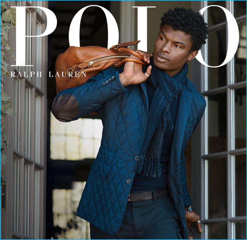 Salieu Jalloh enjoys a casual but chic moment in a blue quilted jacket with patch elbows for Polo Ralph Lauren's fall-winter 2016 campaign.